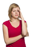 Blonde female having a headache Stock Photography