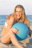 Blonde female laughing with beach ball Royalty Free Stock Image