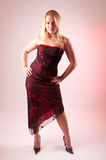 Blonde female model in a long dress and high heels Royalty Free Stock Images