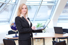 Blonde female office employee Stock Images