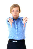 Blonde female shows thums down gesture, isolated Royalty Free Stock Images