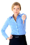Blonde female shows thums down gesture, isolated Royalty Free Stock Image