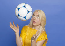Blonde female soccer player with ball Royalty Free Stock Photos