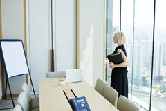 Blonde female is waiting business partner is his private office royalty free stock photos