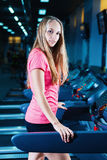 Blonde fitness woman in sportswear with perfect body posing in the gym. Attractive sporty girl resting after sport workout. Royalty Free Stock Photos