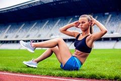 Blonde Fitness Woman on stadium Stock Image