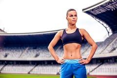Blonde Fitness Woman on stadium Royalty Free Stock Photo