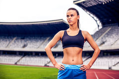 Blonde Fitness Woman on stadium Stock Image