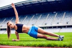 Blonde Fitness Woman on stadium Stock Photo