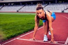 Blonde Fitness Woman on stadium Stock Photography