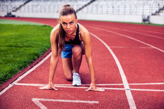 Blonde Fitness Woman on stadium Royalty Free Stock Images