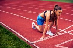 Blonde Fitness Woman on stadium Royalty Free Stock Image