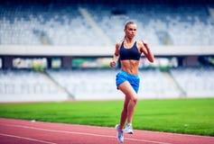 Blonde Fitness Woman on stadium Royalty Free Stock Photos