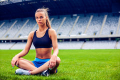 Blonde Fitness Woman on stadium Royalty Free Stock Photography