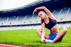 Blonde Fitness Woman on stadium Stock Photos