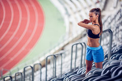 Blonde Fitness Woman on stadium Stock Photo
