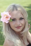 Blonde with flower in hair Royalty Free Stock Photography
