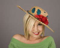 Blonde in Flowered Hat Crooked Smile Royalty Free Stock Photos