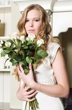 Blonde with flowers Stock Photography