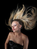 The blonde flying in darkness Stock Photo