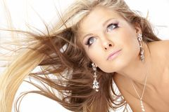 Blonde with flying hair Stock Image