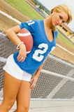 Blonde in Football Jersey Royalty Free Stock Photography