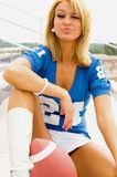 Blonde in Football Jersey Royalty Free Stock Images