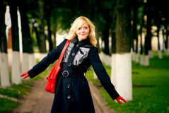 Blonde on footpath in park Royalty Free Stock Photography