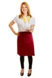 Blonde Frau als Kellnerin, die einen Behälter hält Stockbild