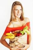 Blonde Frau der Junge recht am Einkaufen mit Lebensmittel in Papiertüteisolator Lizenzfreies Stockbild