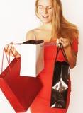 Blonde Frau der Junge recht mit Taschen auf Weihnachten Stockbild