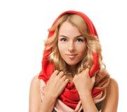 Blonde Frau in der roten Haube. Getrennt auf Weiß. Lizenzfreies Stockfoto