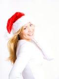 Blonde Frau in der Weihnachtsschutzkappe Stockfotos