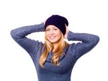 Blonde Frau in der Winterkleidung über Weiß Stockbilder