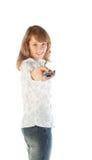 Blonde Frau, die Fernsehentfernte station zielt Lizenzfreies Stockfoto