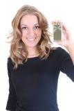 Blonde Frau, die Goldtelefon zeigt Lizenzfreies Stockfoto