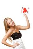 Blonde Frau, die herauf Postkarte steigt Stockbilder