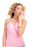 Blonde Frau, die ihr Gefühl zeigt Stockbild