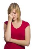 Blonde Frau, die Kopfschmerzen hat Lizenzfreies Stockfoto