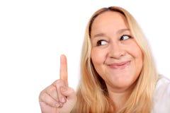 Blonde Frau, die oben zeigt Lizenzfreies Stockbild