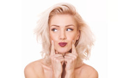 Blonde Frau, die weg schaut Lizenzfreie Stockbilder