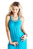 Blonde Frau im blauen Kleid Stockbilder