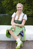 Blonde Frau im Dirndl Stockbilder