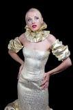 Blonde Frau im goldenen Kleid Stockfotos
