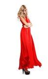 Blonde Frau im langen roten Kleid Lizenzfreie Stockfotos