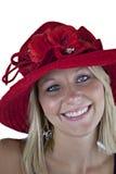 Blonde Frau im roten Hut Stockfotografie