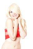 Blonde Frau im roten obersten netten Blick gegen Weiß Lizenzfreie Stockfotografie