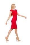Blonde Frau im Scharlachrot Kleid lokalisiert auf dem Weiß Stockbilder