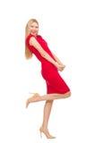 Blonde Frau im Scharlachrot Kleid lokalisiert auf dem Weiß Stockfotografie