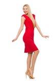 Blonde Frau im Scharlachrot Kleid lokalisiert auf Weiß Stockfotos